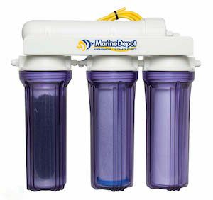 Three-stage reverse osmosis filtration machine with purple cups and white lid which can be used to lower pH in aquariums
